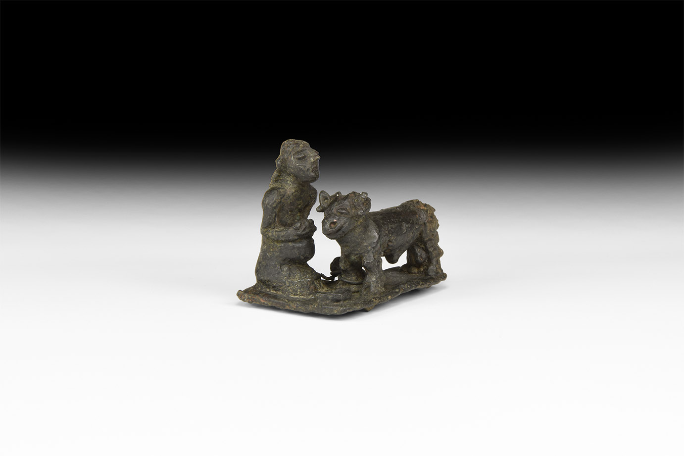 Western Asiatic Kneeling Priest with Sacred Bull Statuette