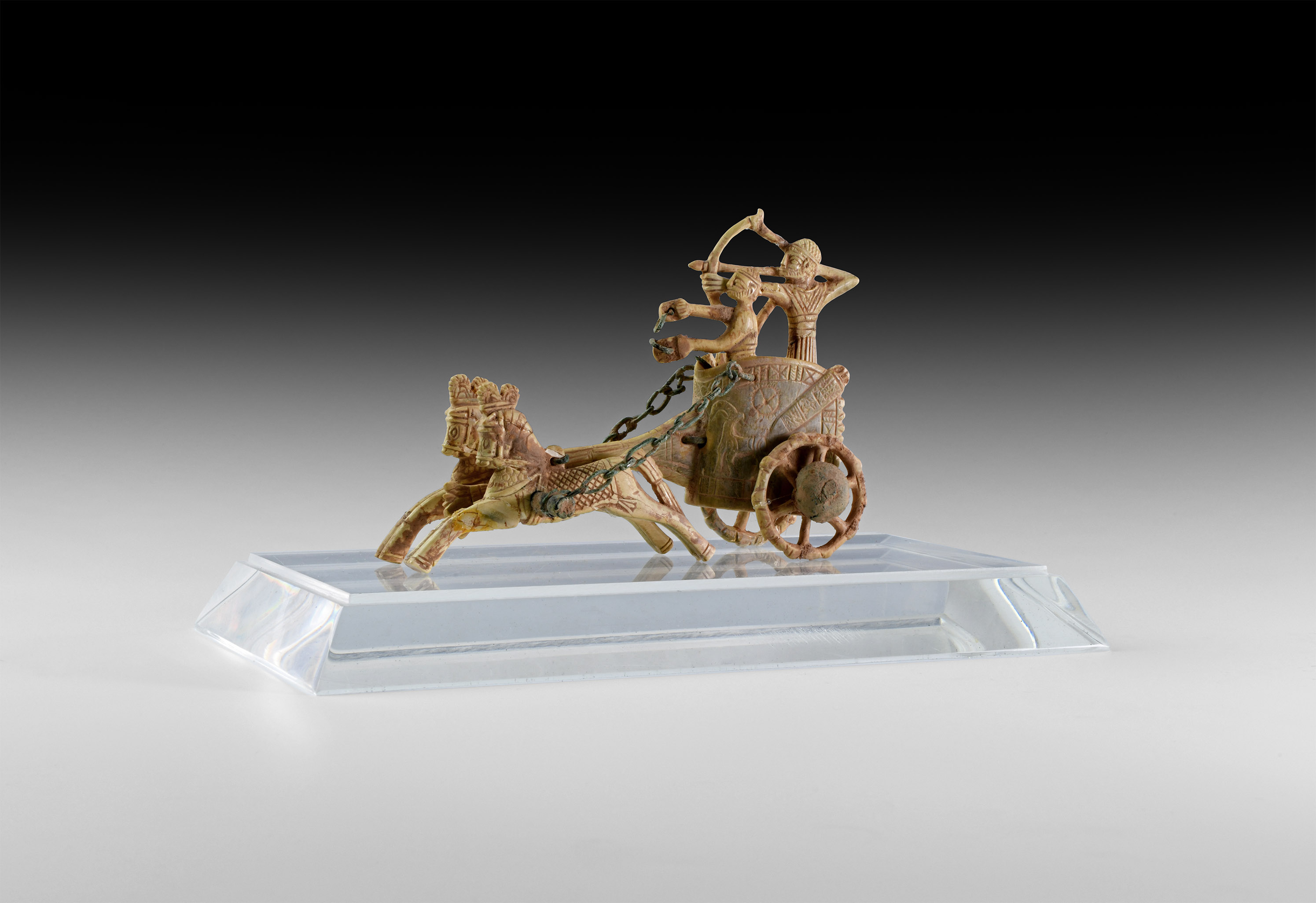Phoenician Ivory War Chariot and Archer with Drawn Bow