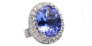 3.61 Carat Oval Shaped Tanzanite 0.35 CT White Diamond 18 KT Gold Stud Earrings