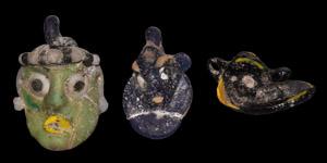 Phoenician Glass Head Pendant Collection