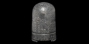 Thimble with A E 1670 and Floral Motif
