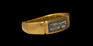 Gold Ring with Inscribed Gemstone