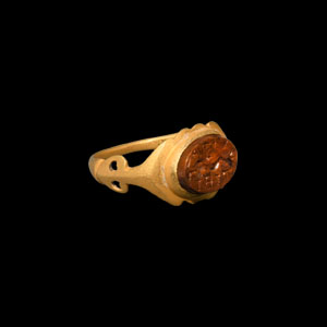 Gold Ring with Dolphin Gemstone