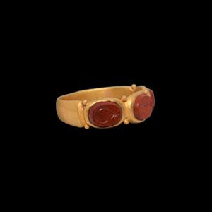 Gold Ring with Three Gemstones
