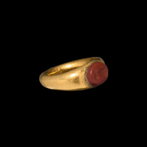 Gold Childs Ring with Bust Gemstone