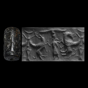 Western Asiatic Cylinder Seal with Deity Fighting Animals