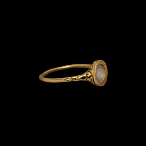 Jacobean Period Gold Ring with Niello Foliate Scrolls and Heraldic Motif