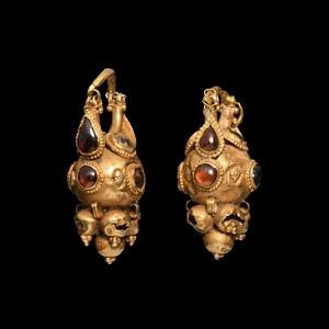 Elaborate Earrings with Garnets