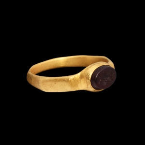 Gold Ring with Vessel Gemstone