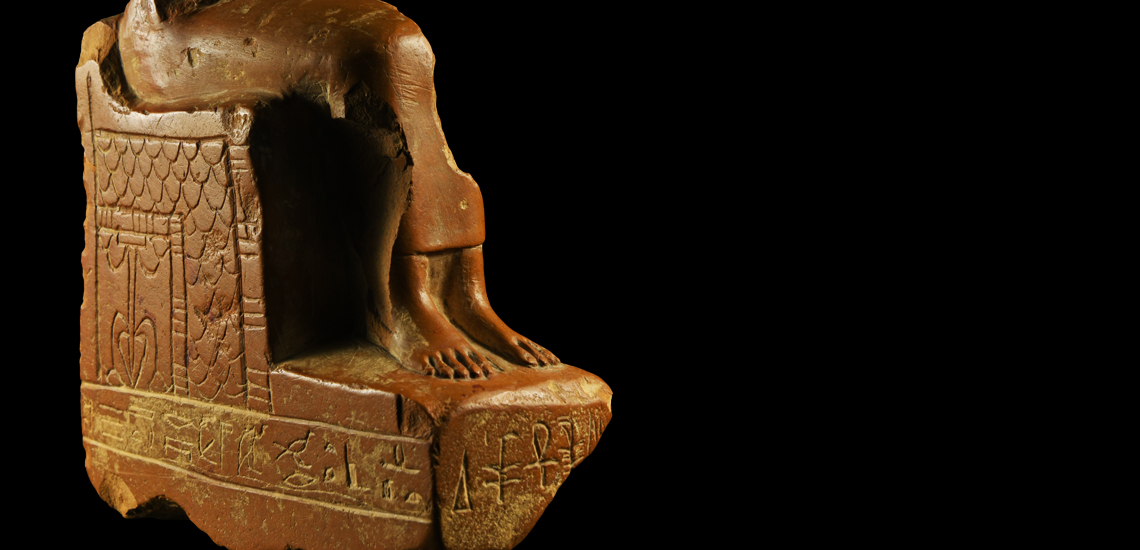 Egyptian Seated Figure with Hieroglyphs